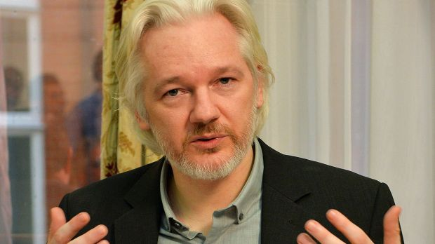Julian Assange gestures during a press conference inside the Ecuadorian embassy in London in August 2014.