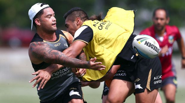 Follow the leader: Issac Luke offloads during Souths training at Redfern Oval.