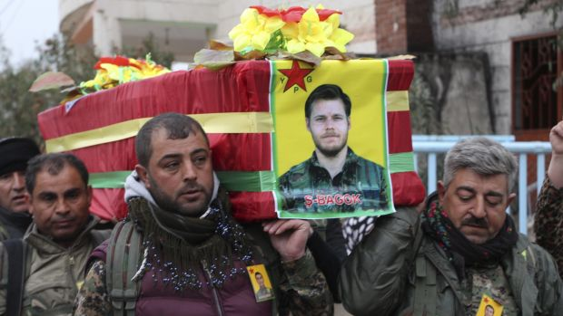 Thousands of Kurdish mourners followed the funeral procession through the streets.