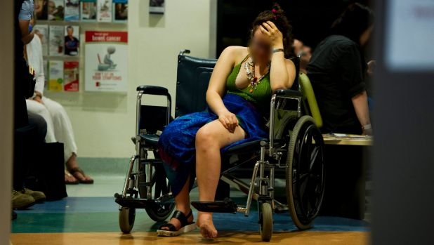 Intoxicated woman waits for treatment  in the waiting room of the emergency department at Calvary Hospital on her ankle ...