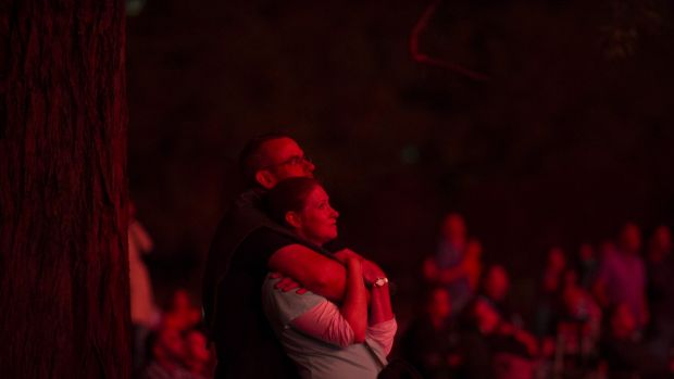 A couple watches the Skyfire celebrations at Lake Burley Griffin.