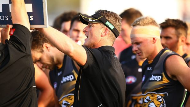 Damien Hardwick talks to his players during a break.