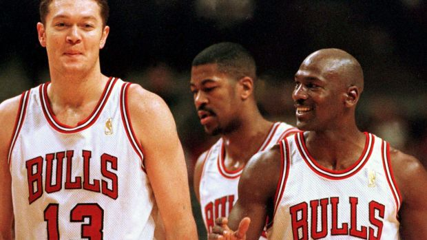 Big man: Luc Longley with Michael Jordan.