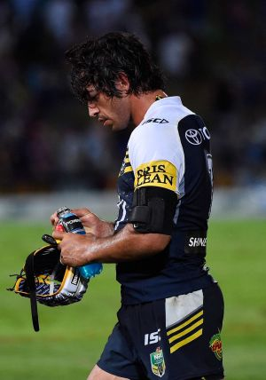 Rough treatment: Johnathan Thurston.
