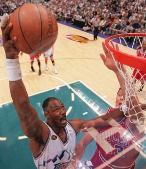 Chicago Bulls' Luc Longley (right) tries to block Utah Jazz's Karl Malone.