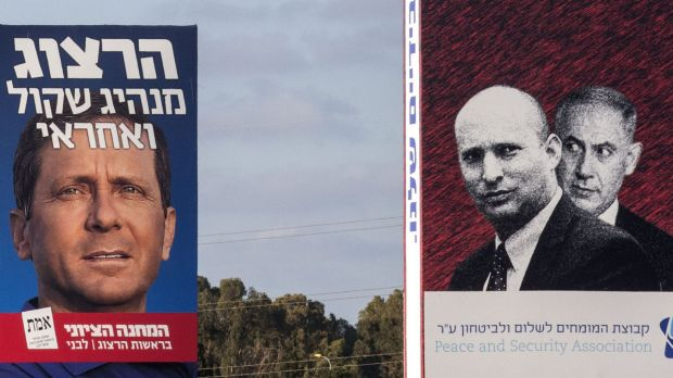 A poster of Zionist Union co-leader Isaac Herzog, left, alongside an anti-Netanyahu poster in Tel Aviv that shows the ...