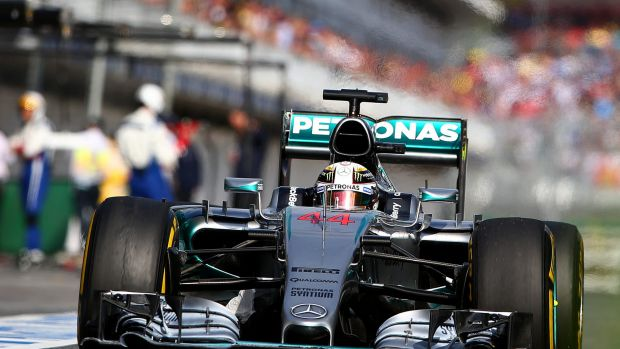 Lewis Hamilton of Great Britain and Mercedes GP leads the pack in the Melbourne Grand Prix.