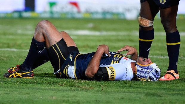 Laid out:  Johnathan Thurston gets his breath back after a shocking double tackle.