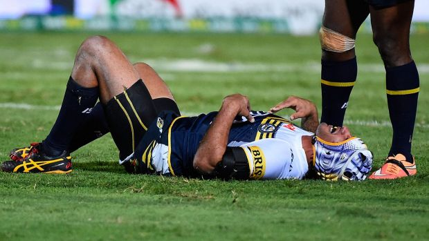 Laid out:  Johnathan Thurston gets his breath back after a late tackle.