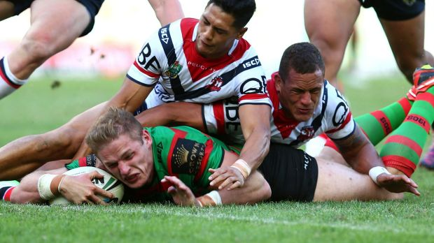 Too late: Roosters defenders fail to stop George Burgess from scoring.