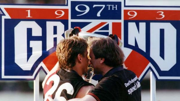 Essendon coach Kevin Sheedy and captain Mark Thompson embrace as they hold the 1993 premiership cup.