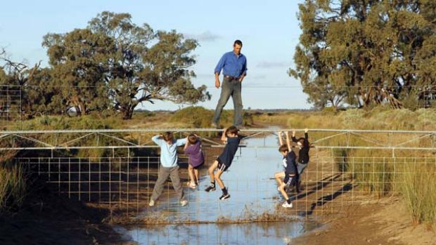 High and dry ... Riverina rice farmer, Jeremy Morton, with some local children. Mr Morton wants to sell his water ...