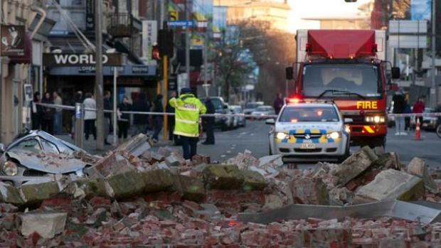 Rubble from a damaged building lies on the street following a 7.1-magnitude earthquake in central Christchurch.