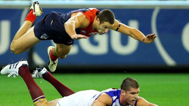 James Frawley leaps over Lions captain Jonathan Brown.