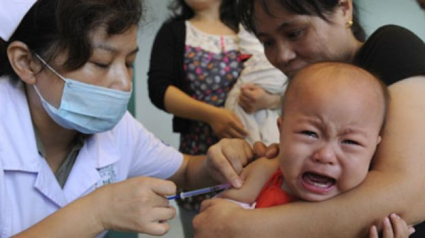 Growth stunted ...  a child wails while being vaccinated against measles at a clinic in Hefei, Anhui province. ...