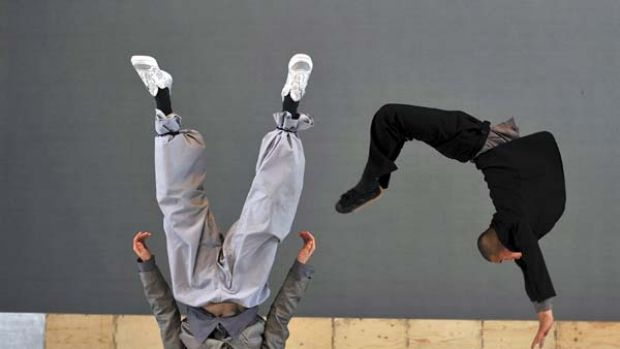 Leaps of faith ... Belgian choreographer Sidi Larbi Cherkaoui and one of the 17 Shaolin monks demonstrate their ...