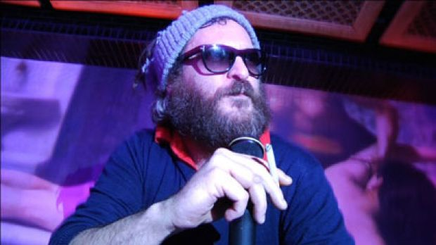 Joaquin Phoenix in hip-hop mode ... if the film is a prank then Phoenix has given the performance of a lifetime, which ...