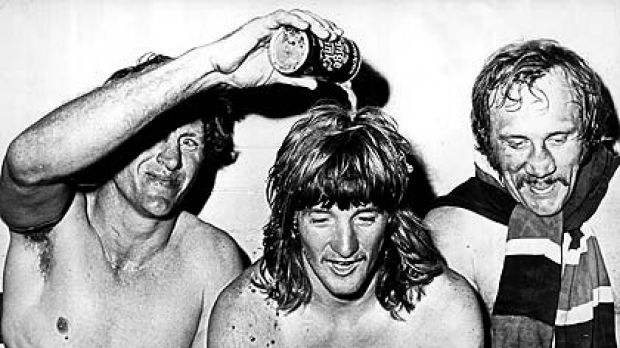 Ron Coote pours a drink over Russell Fairfax's head as a happy Mark Harris looks on after Eastern Suburbs won the Rugby ...