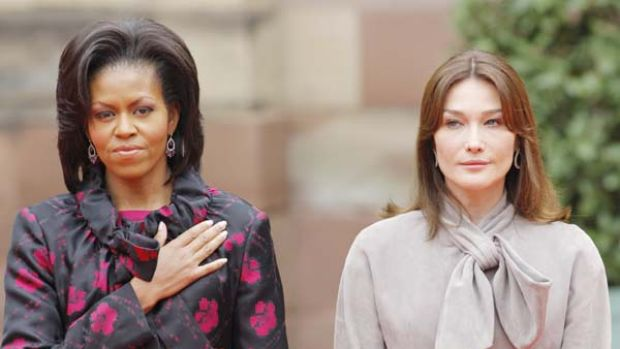 Michelle Obama stands with Carla Bruni-Sarkozy at Palais Rohan in Strasbourg.
