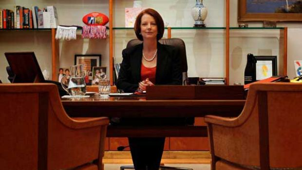 Prime Minister Julia Gillard resumes her seat in her suite at Parliament House.