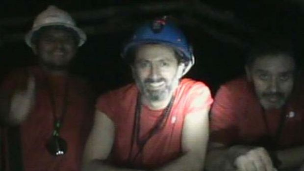 A frame grab shows some of the 33 miners trapped underground in a copper and gold mine at Copiapo, about 725 km  north ...