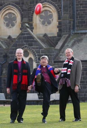 Game on... Perth Archbishop Roger Herft lets rip with a punt,  watched by Melbourne Archbishop Philip Freier (left) and ...