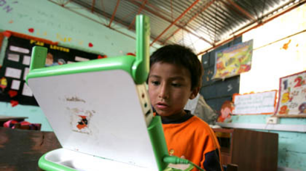 "Renzo reads on his ""XO"" laptop in Arahuay, an Andean hilltop village in Peru."