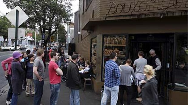 People wait patiently at Bourke Street Bakery in Surry Hills