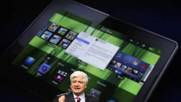 Mike Lazaridis, president and co-chief executive officer of Research in Motion, holds the new Blackberry PlayBook with a ...