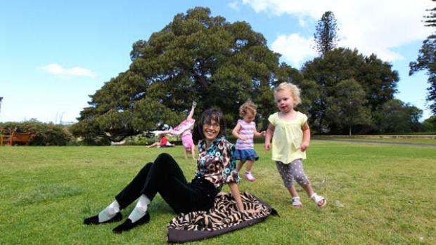 Freedom before fear ... children frolic while Lenore Skenazy kicks back in the Sydney Botanical Gardens.