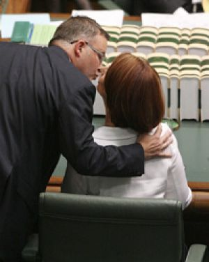 Anthony Albanese kisses the PM.