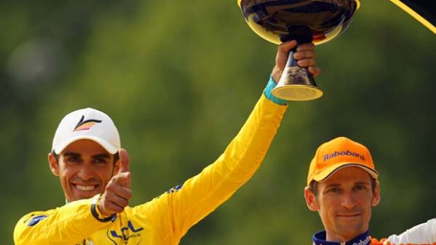 Alberto Contador of team Astana celebrates with his traditional pistol pose after winning this year's Tour de France.