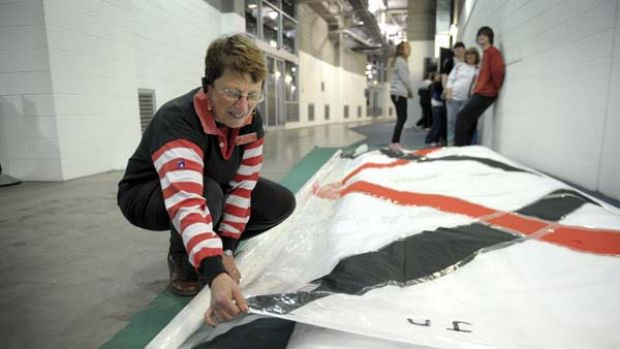 Pam Mawson works on Saints' banner No. 2.