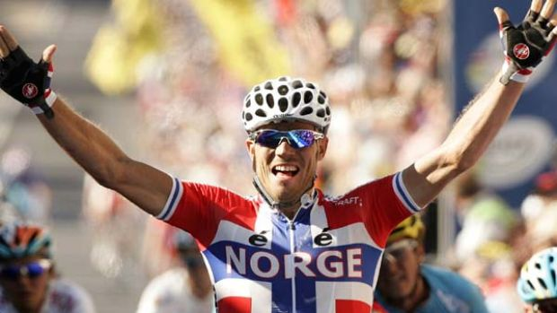 The Gold of Thunder . . Thor Hushovd celebrates as he crosses the finish line.