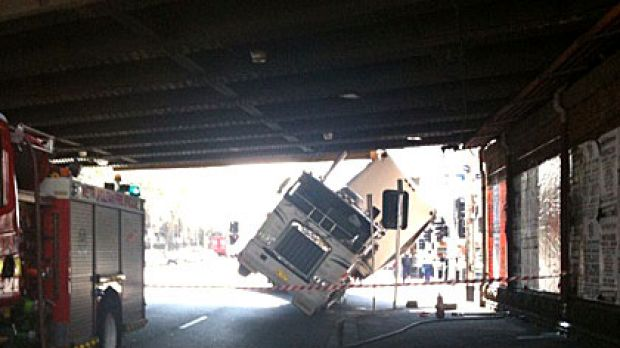 A truck wedged under the rail bridge at the intersection of Flinders and Spencer streets earlier this afternoon.