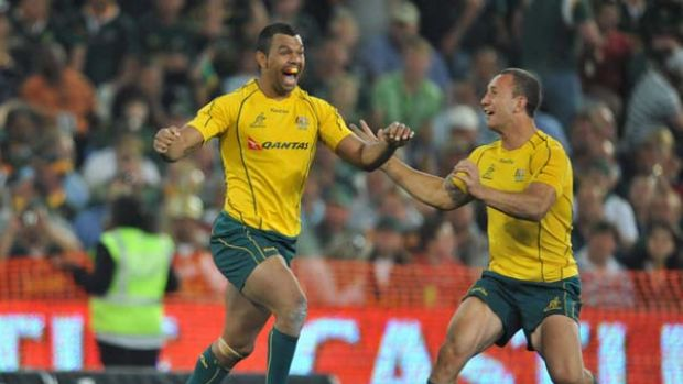 Kurtley Beale celebrates his winning penalty goal against South Africa with Quade Cooper.