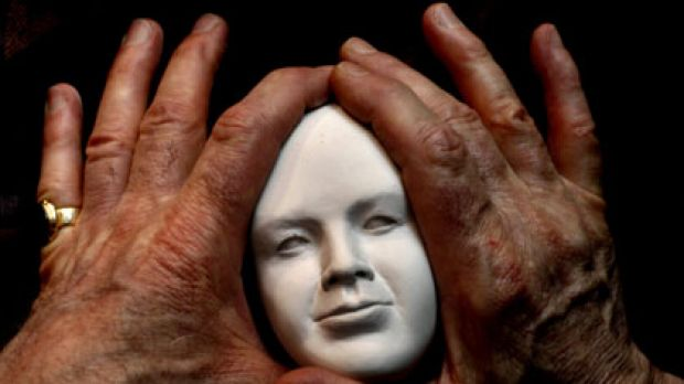 Redfern artist John Jewell holds an unfinished bust of Mary MacKillop.