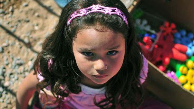Waiting game ... a daughter of one of the 33 trapped miners plays in a camp near the San Jose mine in Chile. The first ...