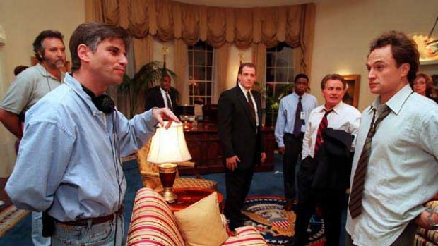 Aaron Sorkin (front left) on the set of West Wing with Martin Sheen (second from right) and Bradley Whitford (far right).