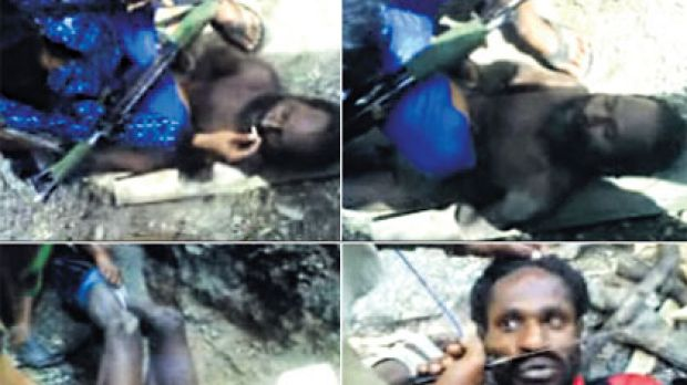 ''Get a fire'' ... video posted on YouTube shows two Papuan men being tortured by apparent members of the Indonesian ...
