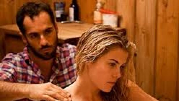 Stress relief: Michael (Alex Dimitriades) and Heidi (Rachael Taylor) wind down after a hard day picking oranges in the ...