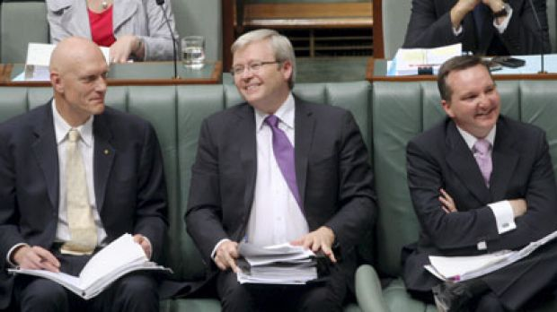 Centre of attention ... the globetrotting Foreign Minister takes his place on the frontbench for question time yesterday.