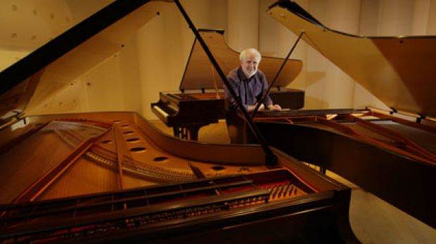 Mother of all grands ... Wayne Stuart of Stuart & Sons leans on the mega-grand in his Newcastle workshop. The piano has ...