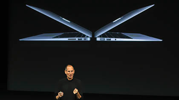 Apple CEO Steve Jobs unveils the company's latest high-end ultra-thin MacBook Air laptop models during a news conference ...