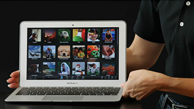 An Apple employee displays the new MacBook Air during an Apple special event at the company's headquarters.
