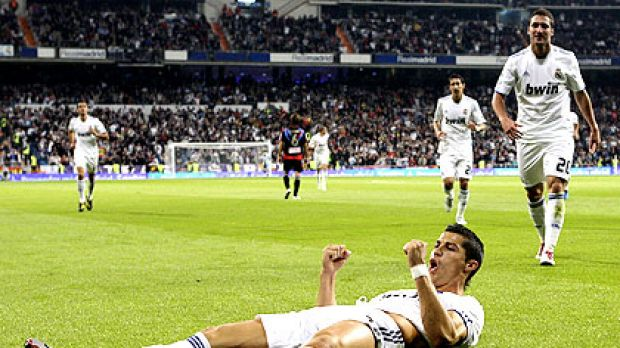 Real Madrid's Cristiano Ronaldo takes a laid-back approach to celebrating one of his record four goals that helped knock ...