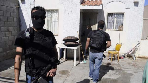 Police officers stand guard at the crime scene in Ciudad Juarez.