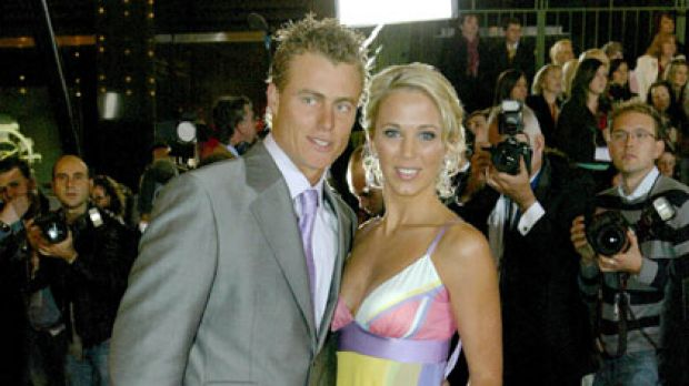 Cashing in ... Lleyton and Bec Hewitt.