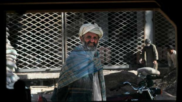 An Afghan stares through the window of a Humvee in central Heret, Afghanistan's third largest city.