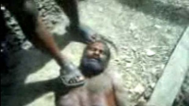 An image from the video of Tunaliwor Kiwo being tortured by Indonesian soldiers.